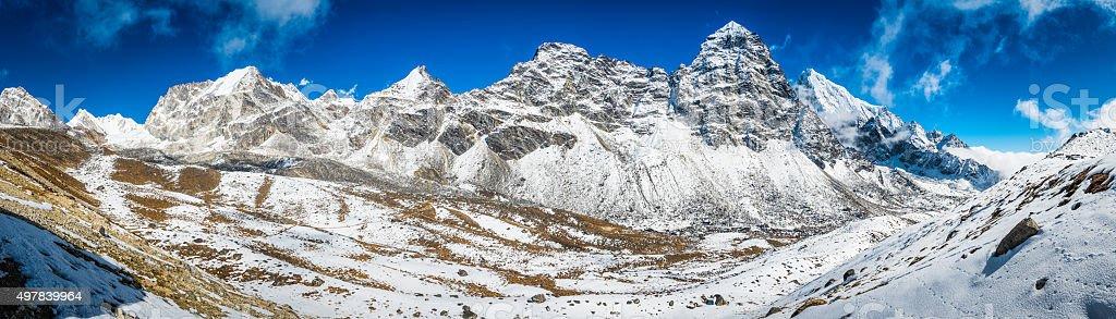 Trail through Himalaya mountain peaks wilderness Cho La pass Nepal stock photo