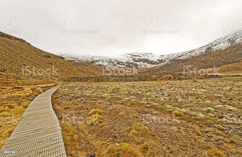 Trail to a snowy peak stock photo
