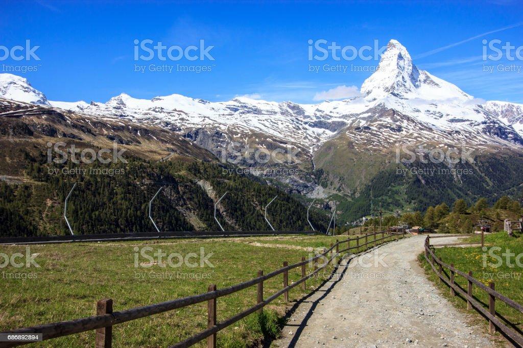 Trail with view of Matterhorn Peak in summer at Sunnega station, Rothorn Paradise, Zermatt, Switzerland. stock photo