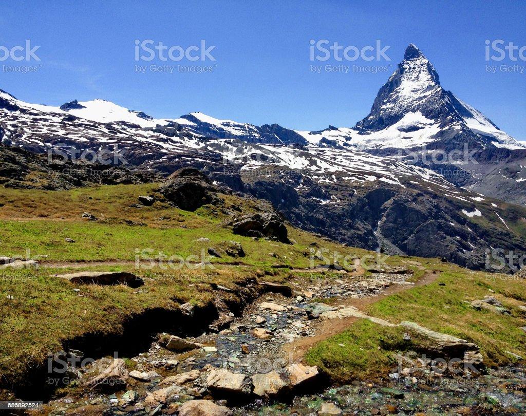 Trail with view of Matterhorn Peak in summer, Zermatt, Switzerland.; stock photo