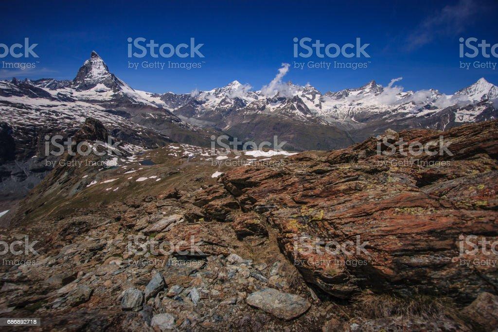Trail with view of Matterhorn Peak in summer, Zermatt, Switzerland. stock photo