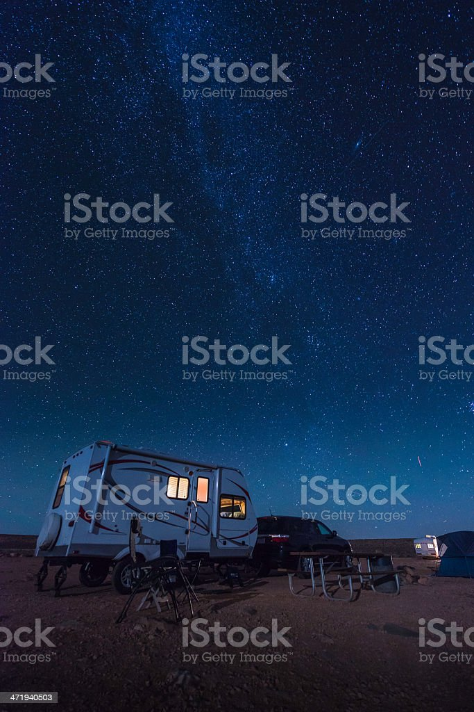 Trailer camping in desert under stars and Milky Way USA stock photo