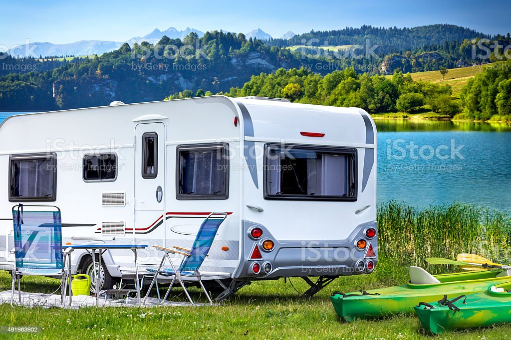 Trailer Home in the mountains stock photo
