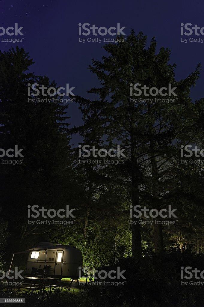 Trailer illuminated in star forest night Oregon stock photo