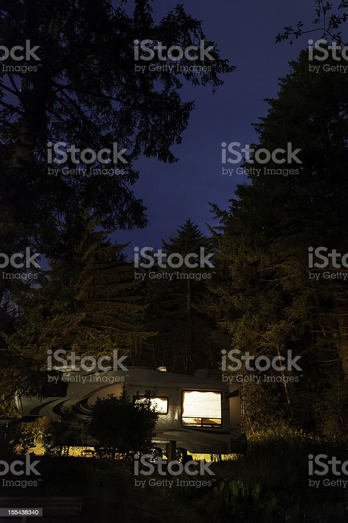 Trailer illuminated in state park under starry skies USA royalty-free stock photo