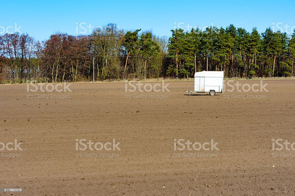Trailer on field stock photo