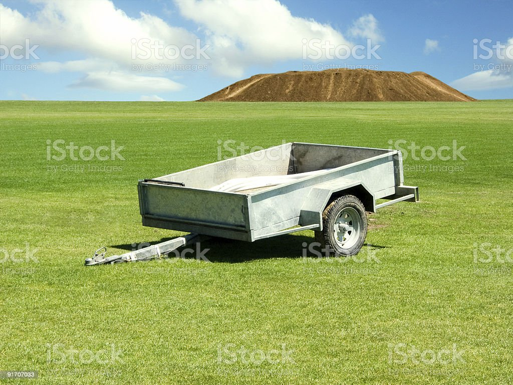 Trailer on green field royalty-free stock photo