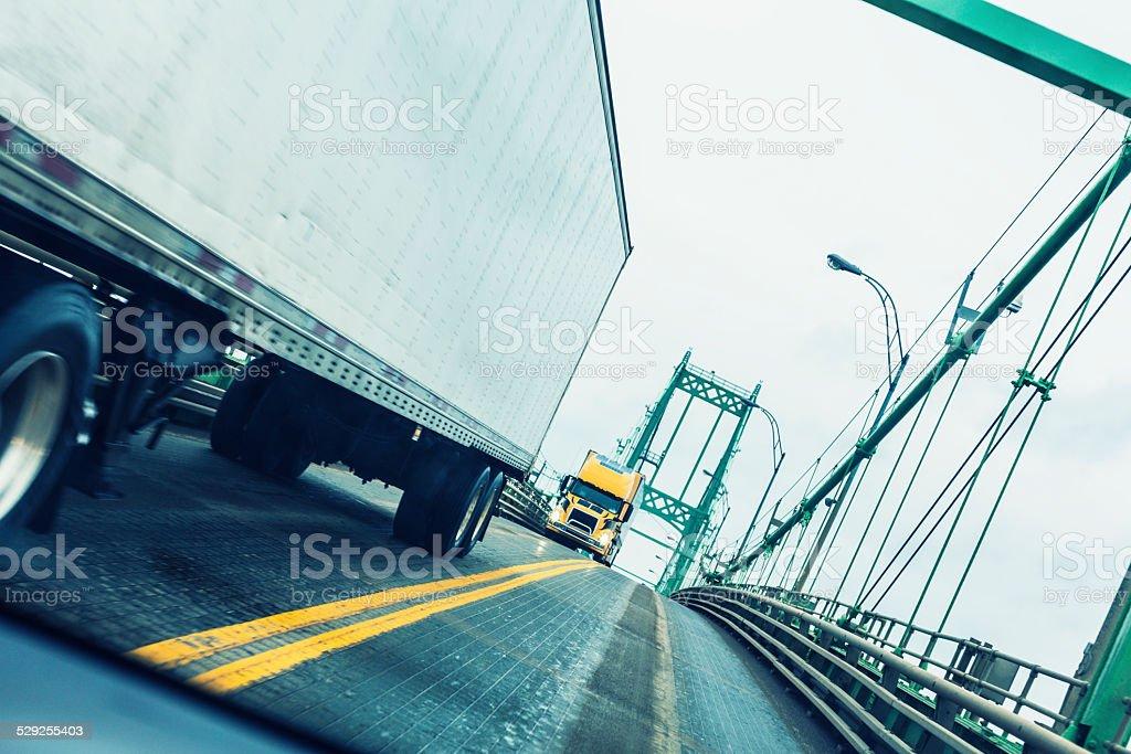 Trailer Trucks Passing On Thousand Islands Suspension Bridge Expressway stock photo