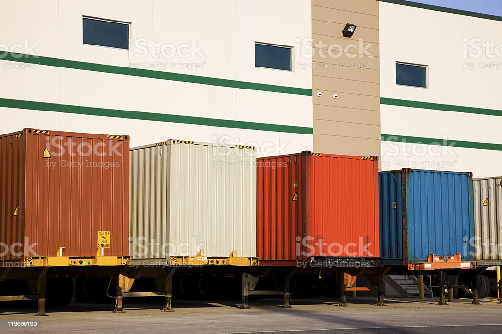 Trailers by the warehouse stock photo