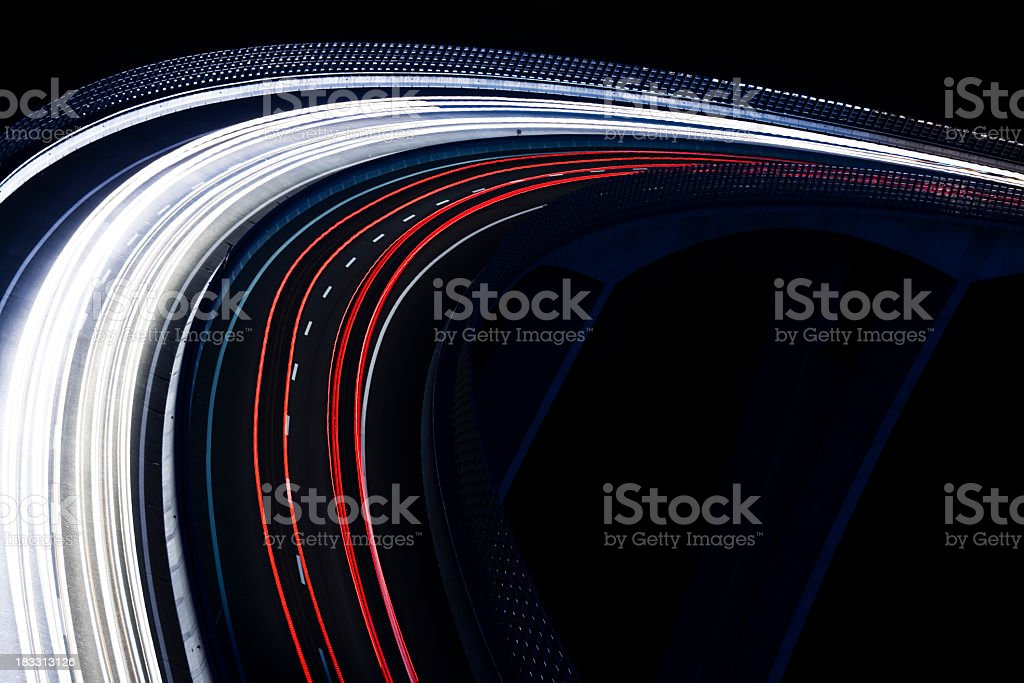 Trails for a traffic light on a black background stock photo