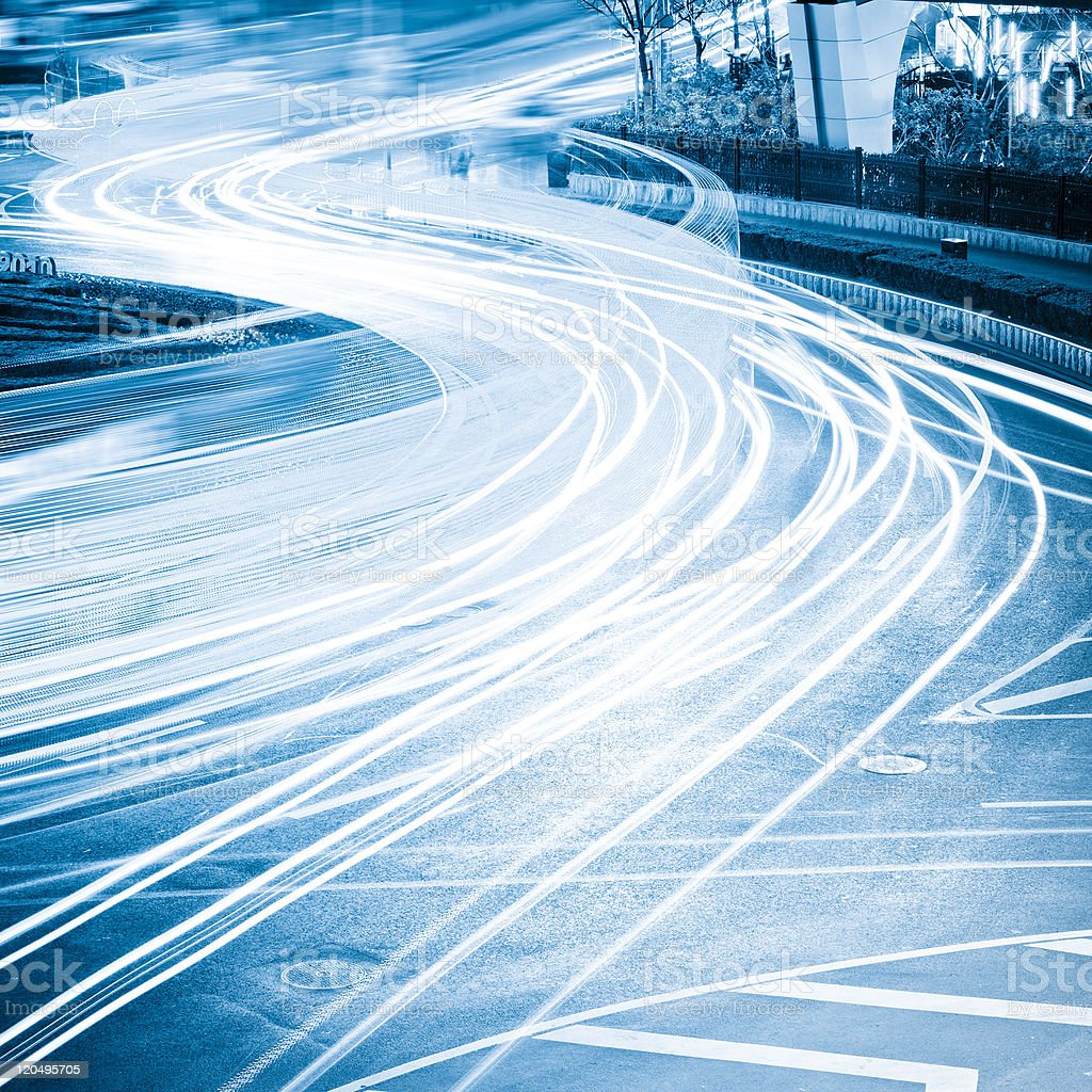 Trails of blue and white blurred lights royalty-free stock photo