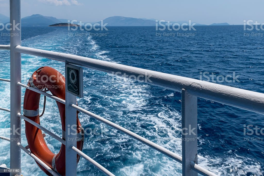 Trails of the ship in the blue sea stock photo