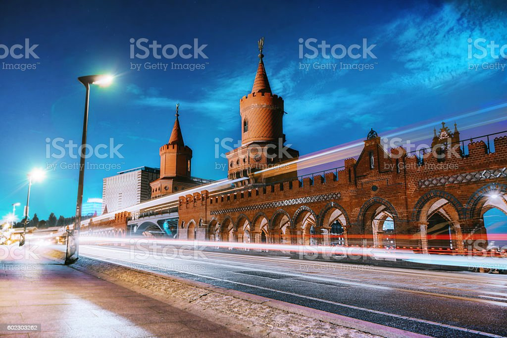 train and cars passing Berlin Oberbaumbrücke at blue hour stock photo