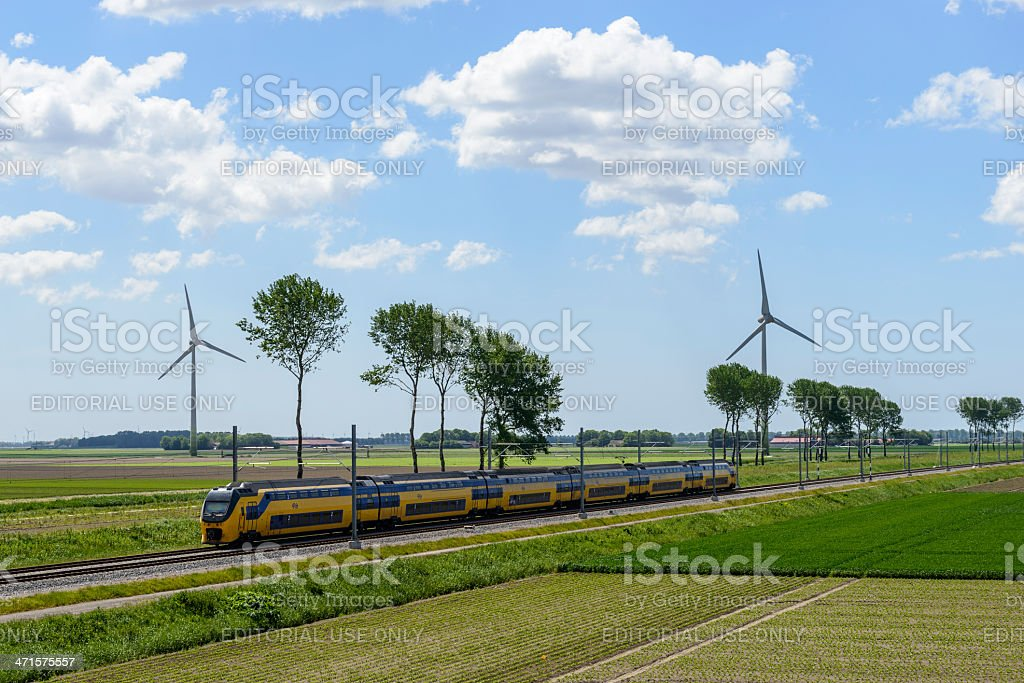 Train and wind energy stock photo