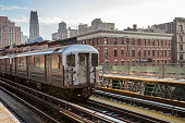 Train Approaching  Elevated Subway Station in Harlem, New York