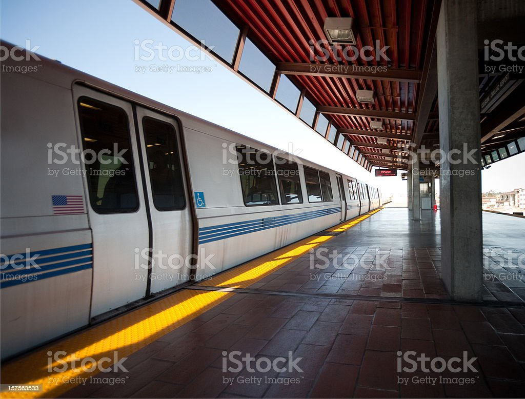 BART train arrives at station stock photo