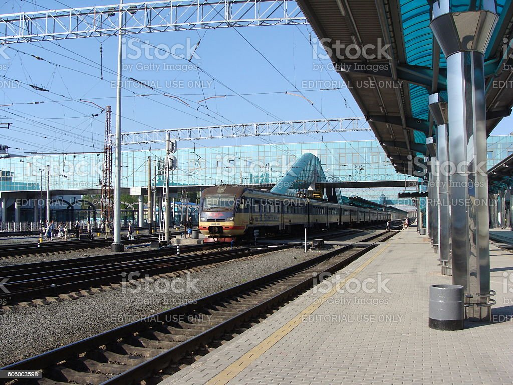Train Arriving at a Modern Railway Station stock photo