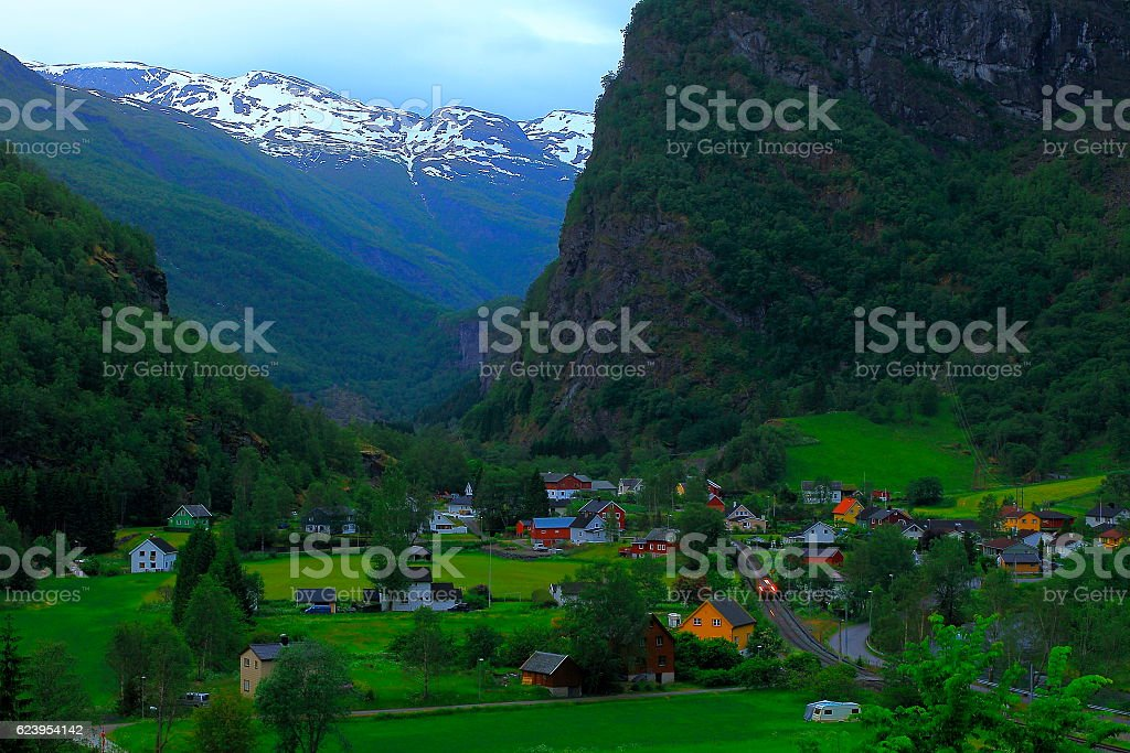 Train arriving in Flam norwegian village evening from above, Norway stock photo