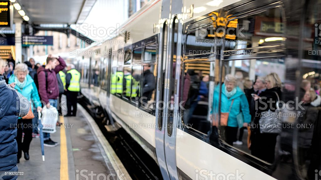 Train At Platform & People. Soft Focus. Railway Station Background. stock photo