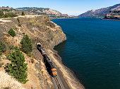 Train BNSF by Columbia River in Tunnel Washington State Oregon