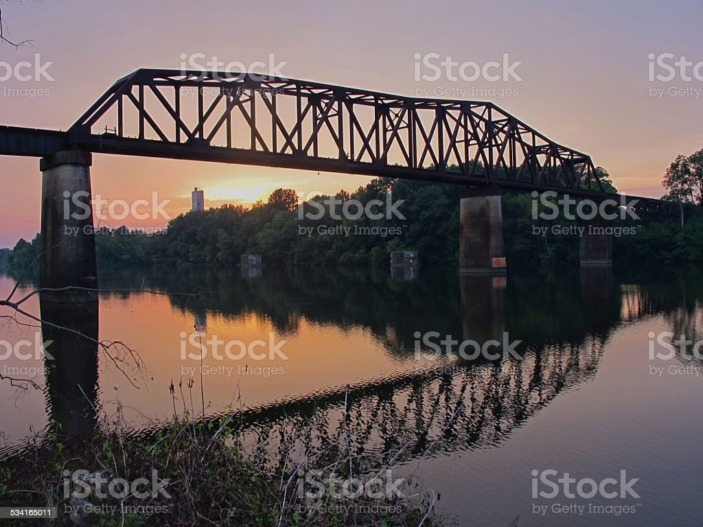 Train Bridge Reflections at Sunset stock photo