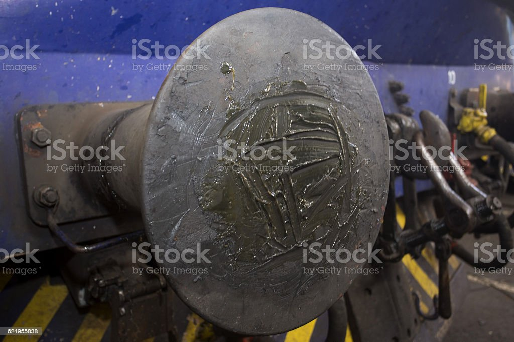 Train bufer smeared with grease stock photo