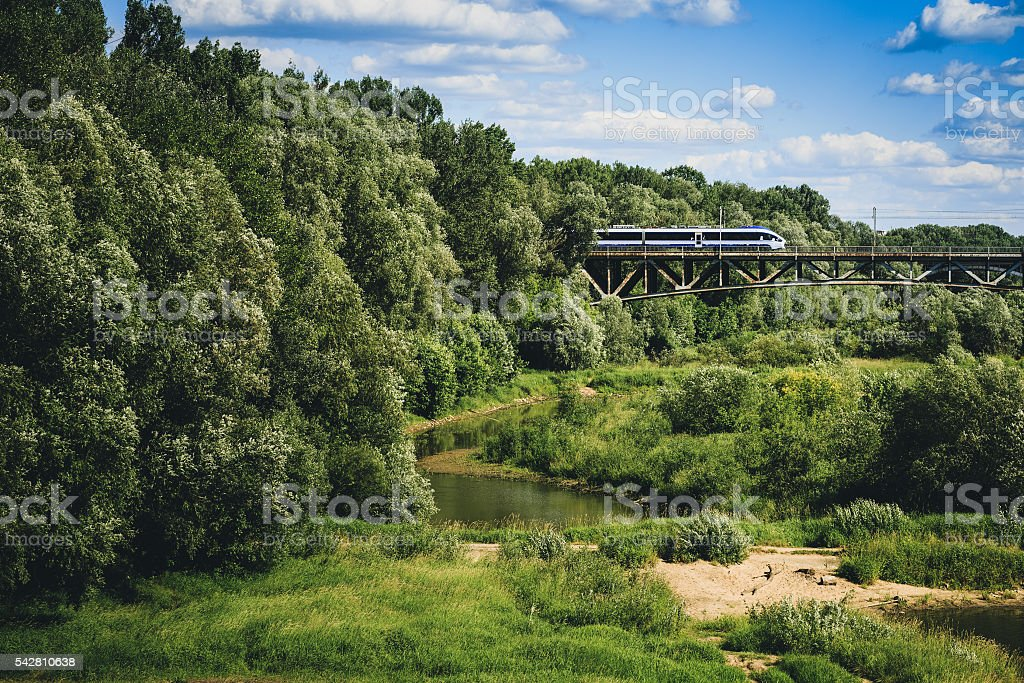 Train coming out of the trees. stock photo