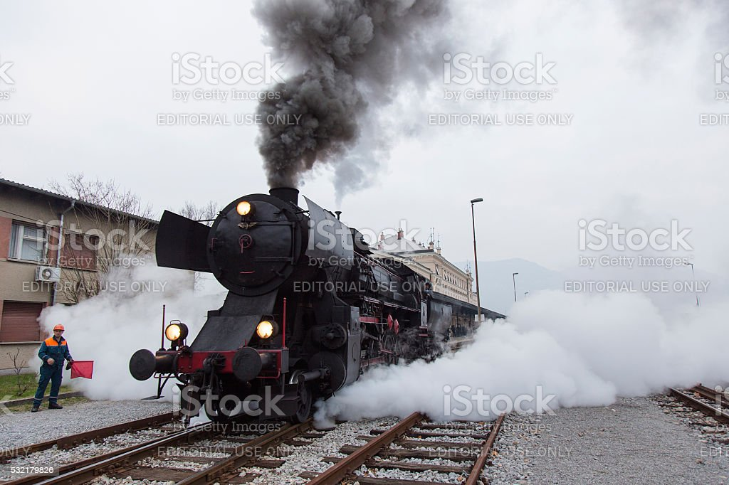 Train Conductor and Old Steam Locomotive on Railway station stock photo