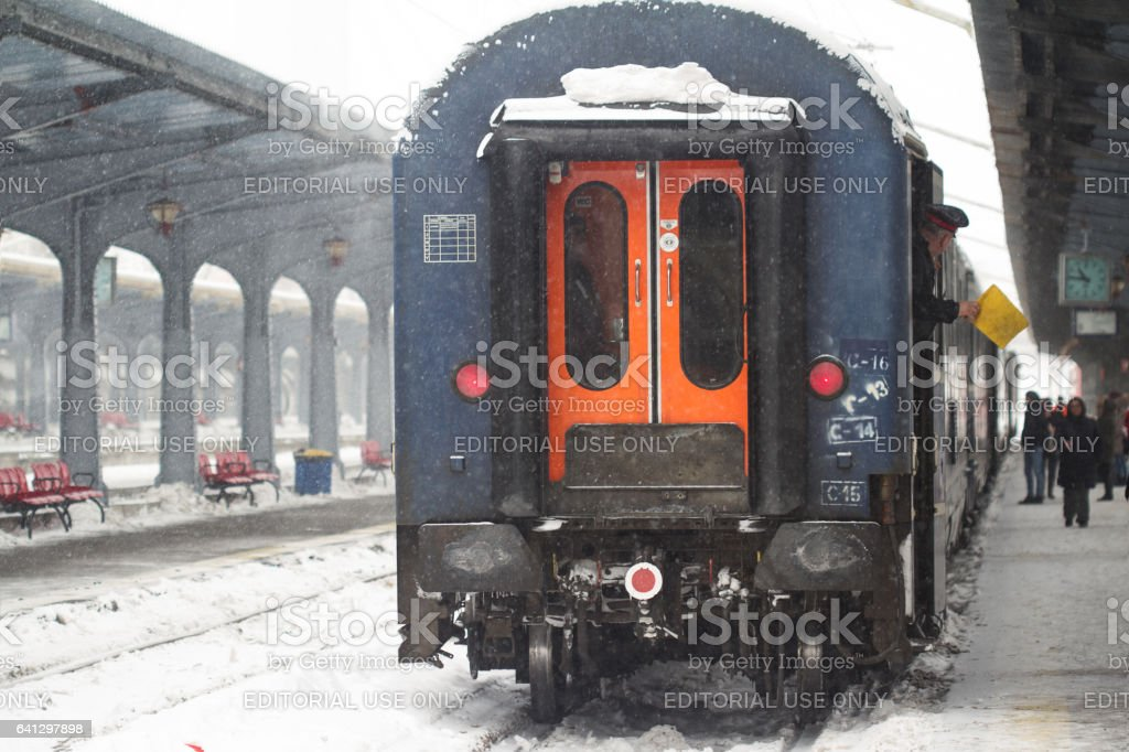Train conductor giving the departure signal stock photo