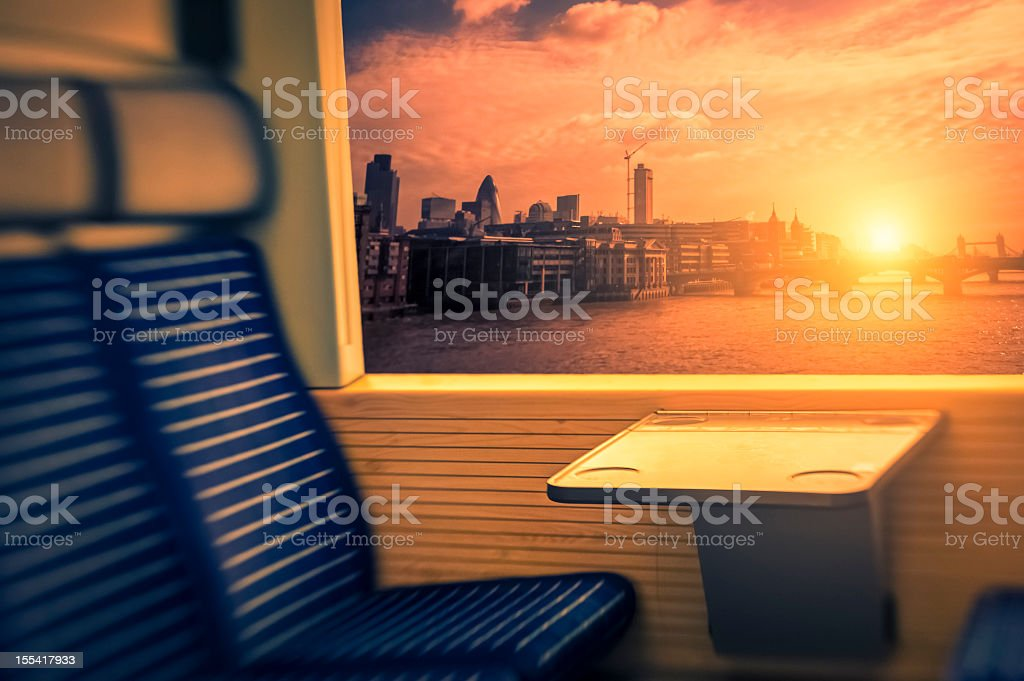 Train crossing a bridge in London during sunset royalty-free stock photo