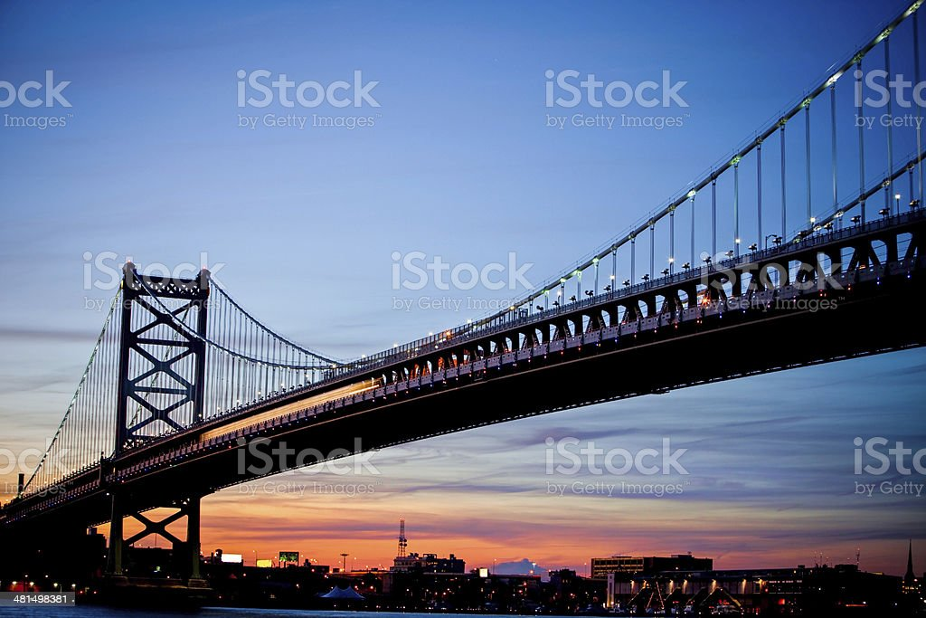 Train crossing the Ben Franklin Bridge on Philadelphia side stock photo