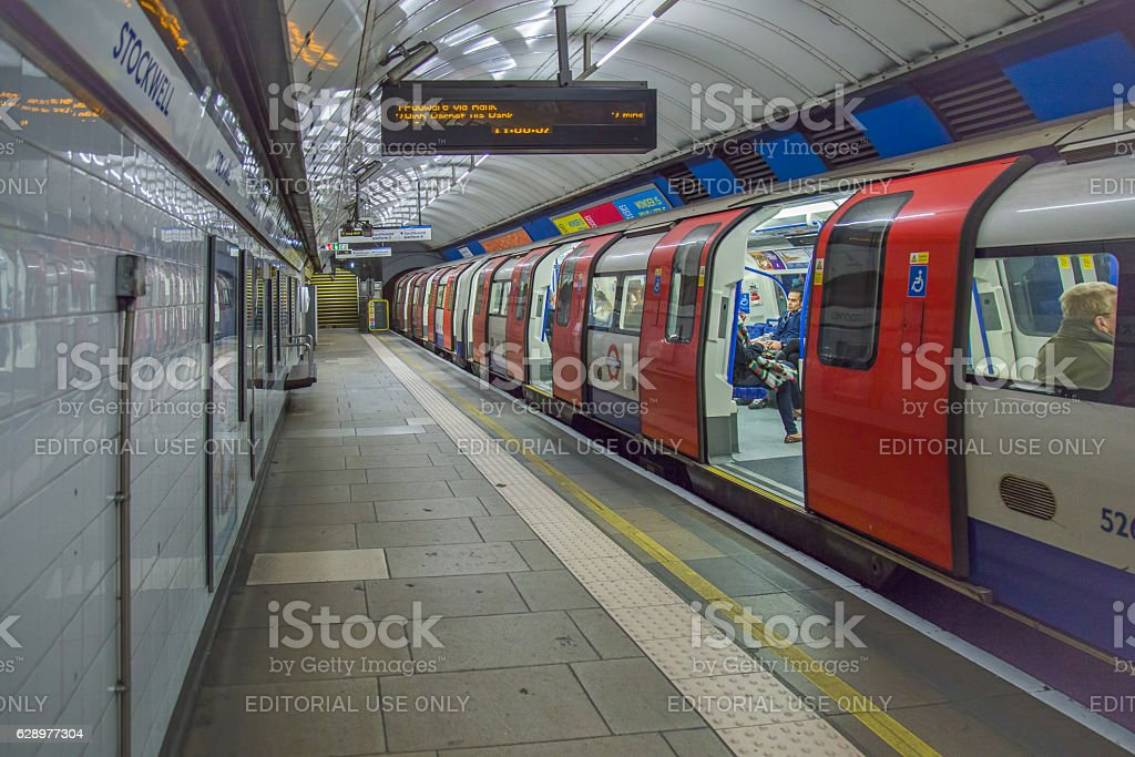 Train departing from an underground Tube Station in London, England. stock photo