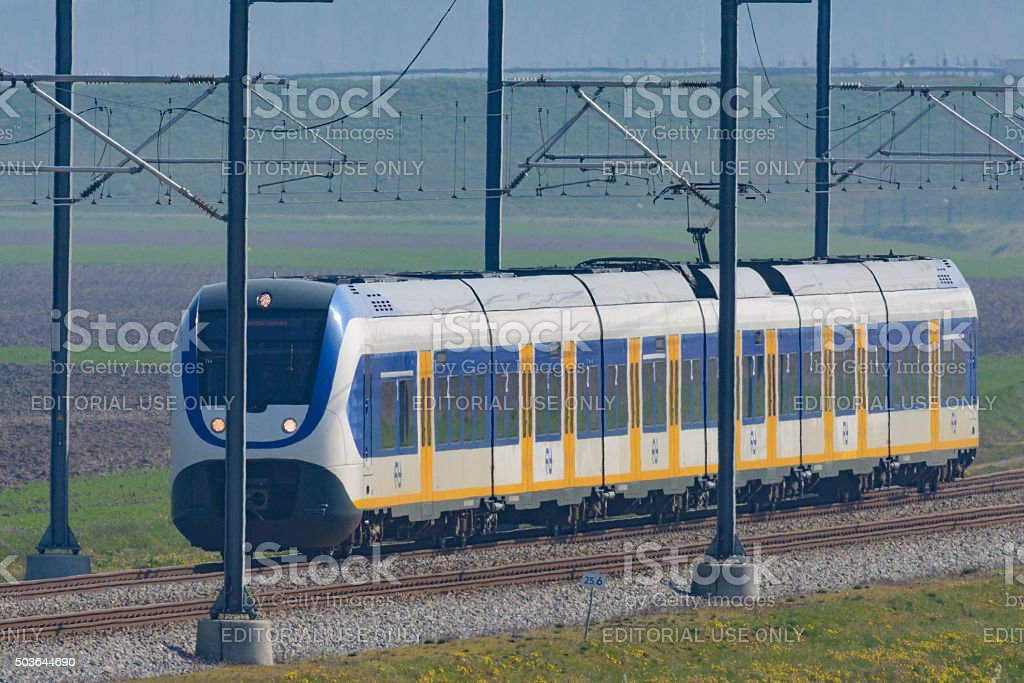 Train driving in a rural landscape in The Netherlands stock photo