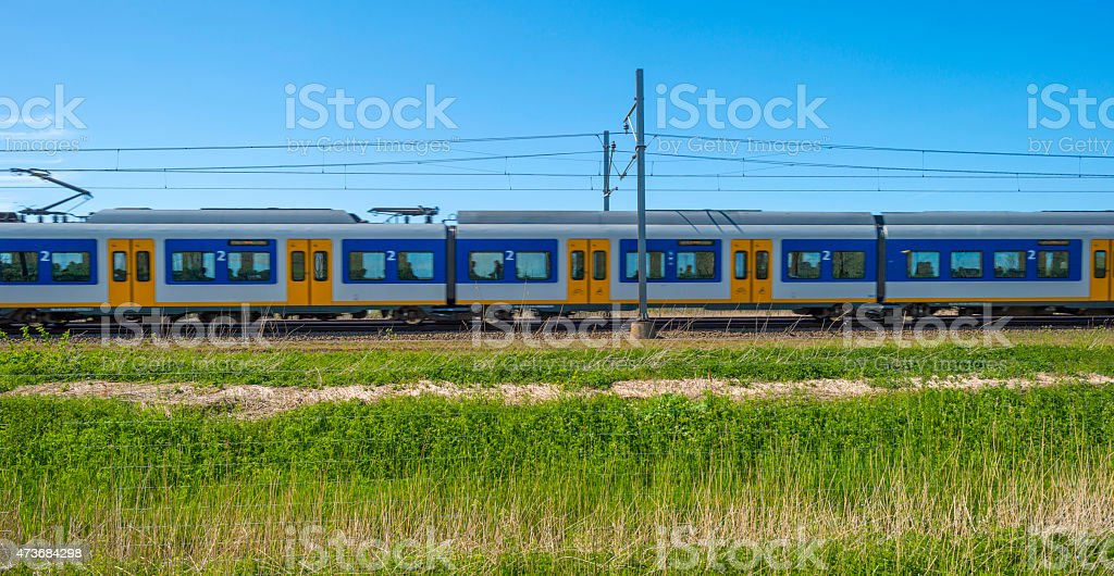 Train driving through nature in spring stock photo