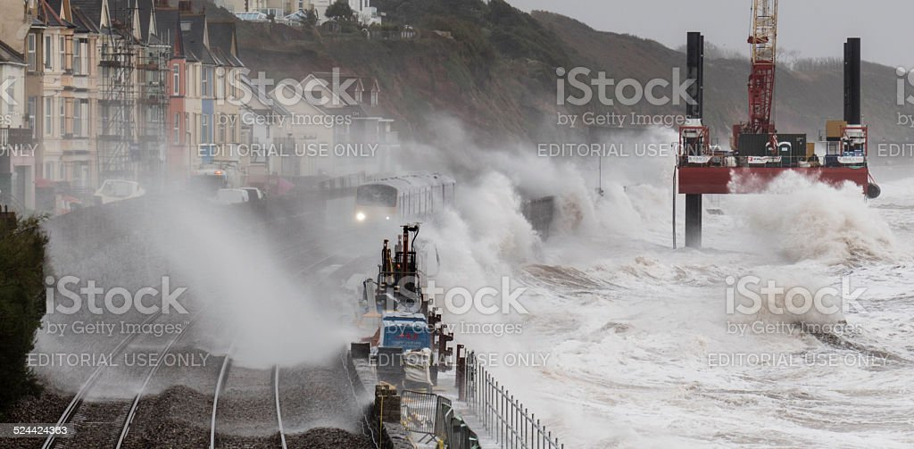 Train getting soaking at Dawlish where the line was damaged stock photo