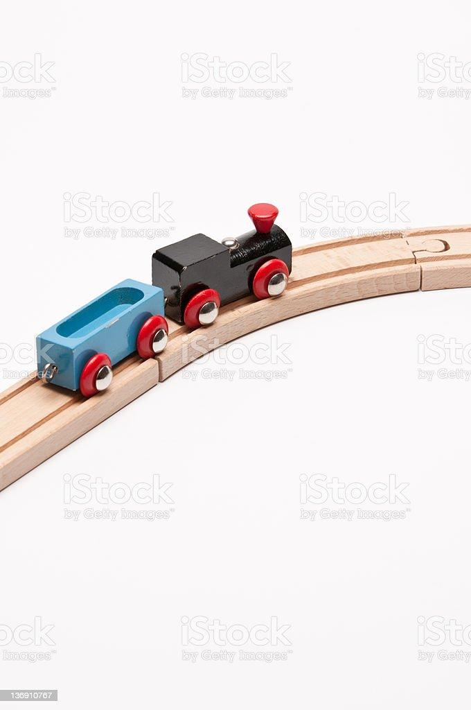 Train dans un virage avec blue Waggon photo libre de droits