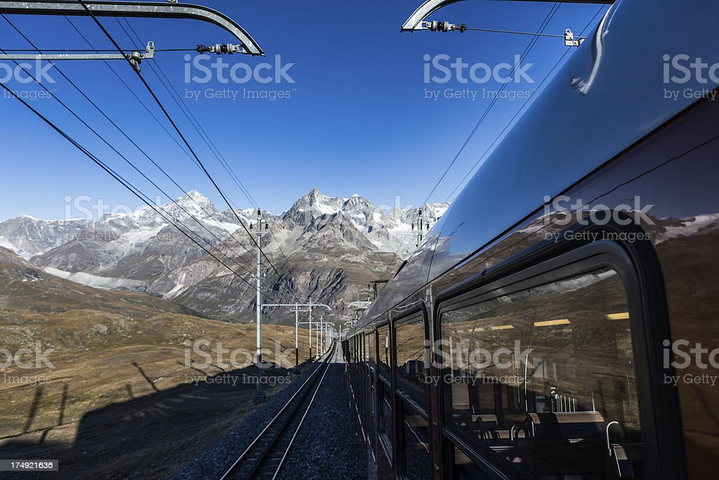Train in the Swiss Alps stock photo