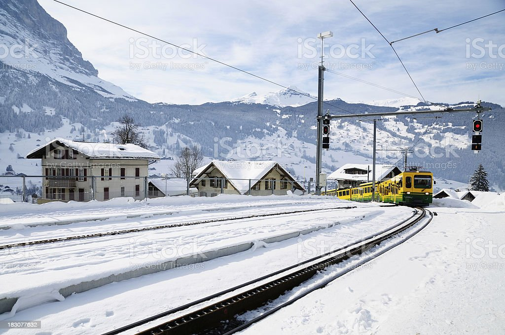 Train is coming in winter, Grindelwald, Switzerland royalty-free stock photo