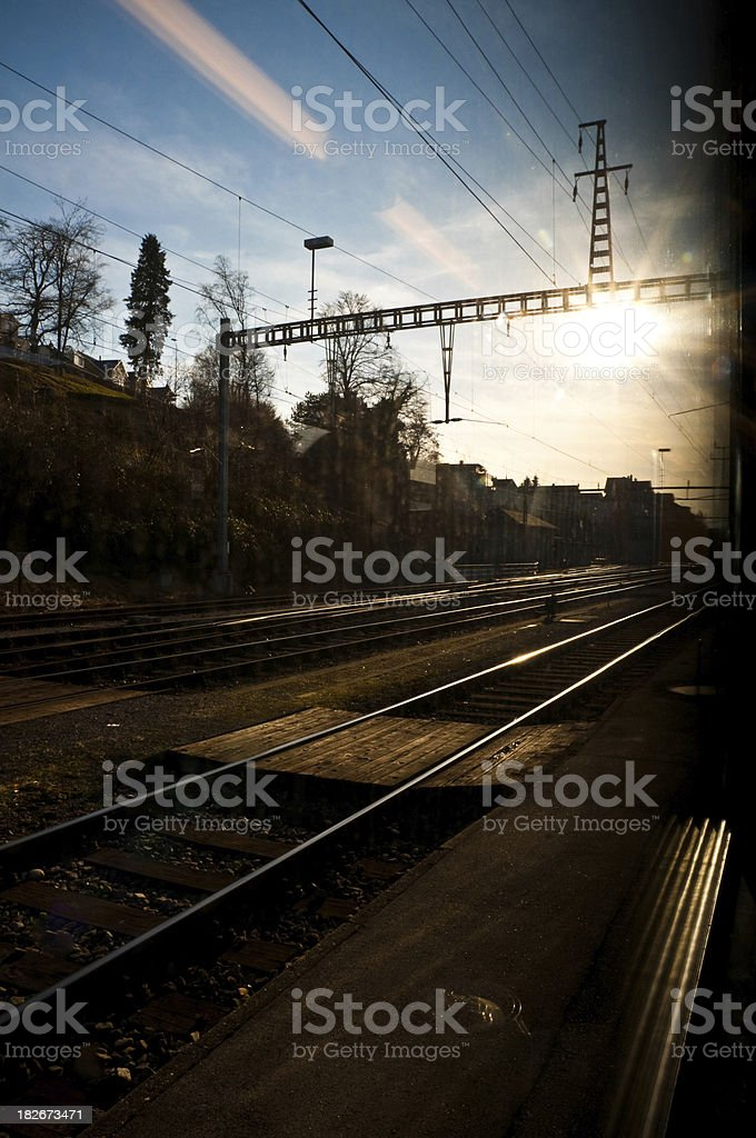 train is leaving and I'm looking into the sun stock photo