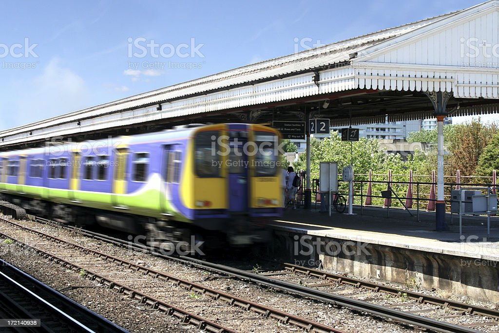Train leaving Clapham Junction station in London stock photo