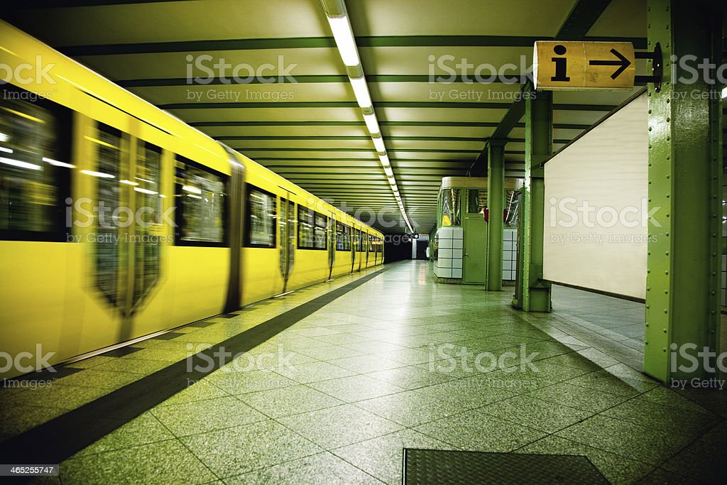 train leaving empty subway station in Berlin royalty-free stock photo