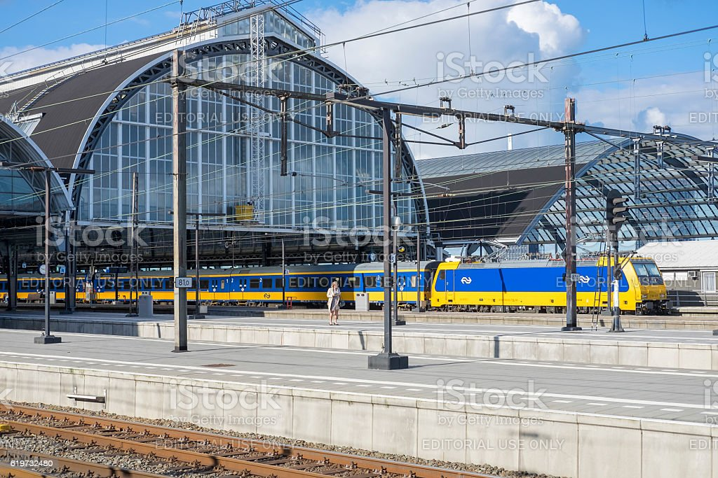 Train of Dutch Railways or NS at Amsterdam Central Station stock photo