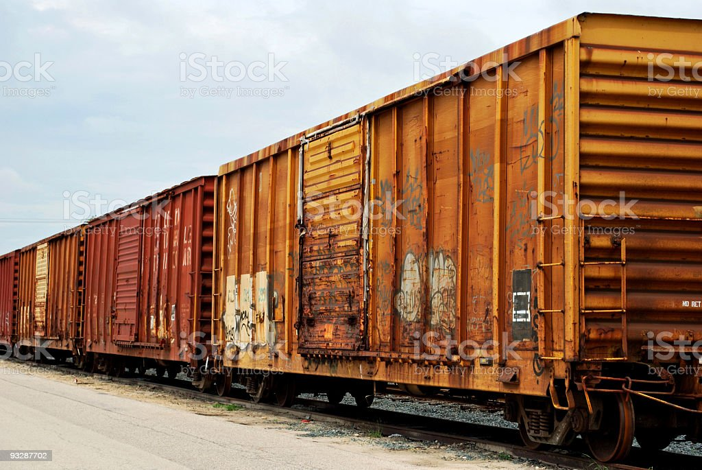 Train of Old Boxcars with Tracks royalty-free stock photo