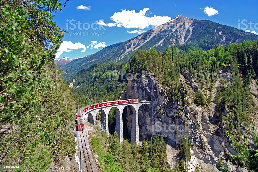 Train of the Rhaetian Railway on the Landwasser viaduct. stock photo