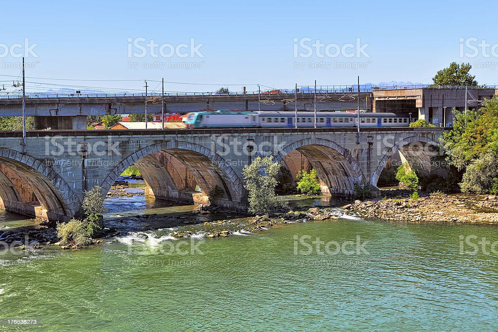 Train on bridge over the river in Piedmont, Italy. royalty-free stock photo
