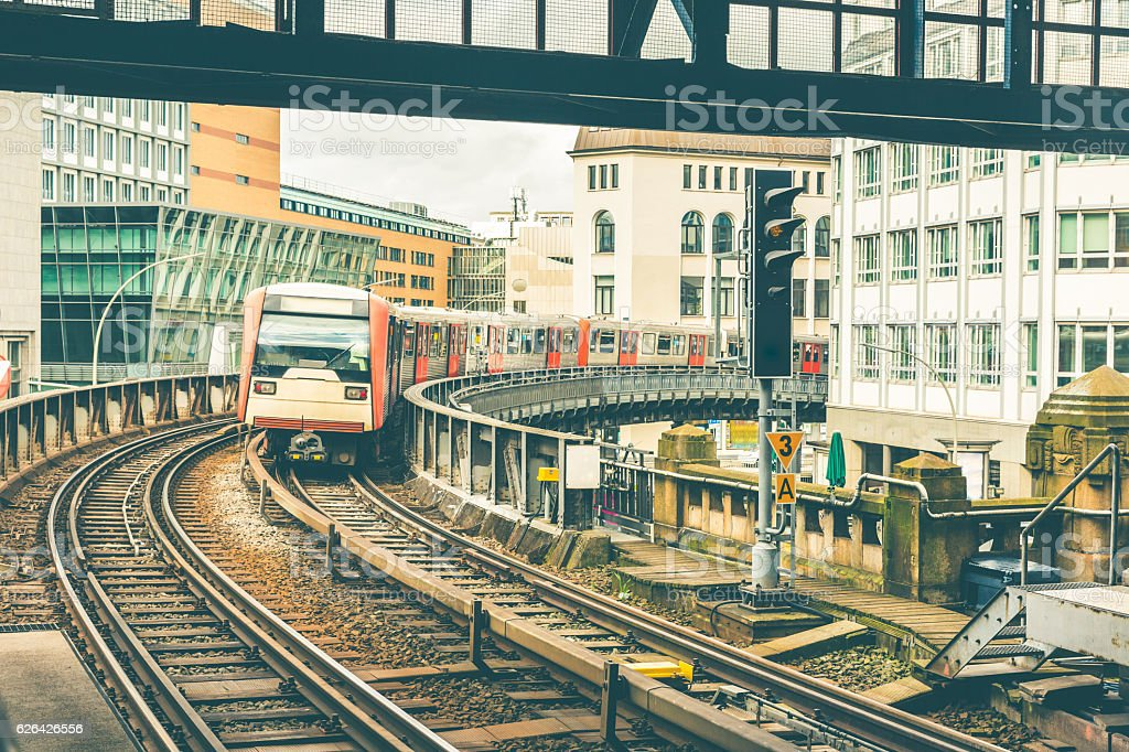 Train on elevated tracks coming to the station in Hamburg stock photo