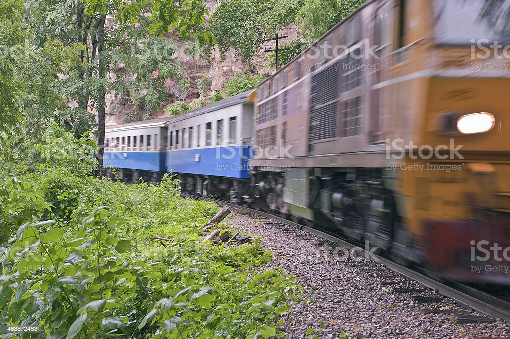 train on old rail in forrest. royalty-free stock photo