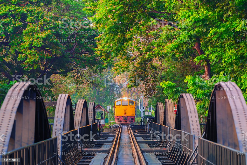 Train on the bridge over the river Kwai in Kanchanaburi, Thailand. stock photo