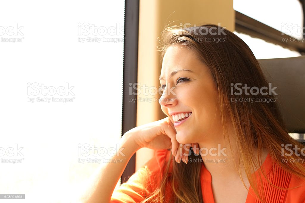 Train passenger traveling looking through window stock photo