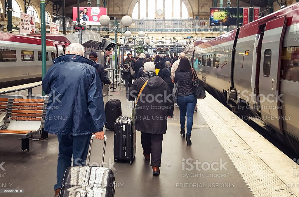 Train passengers arriving at Gare du Nord in Paris stock photo